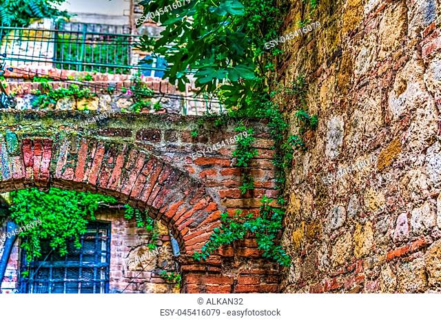 Detail of an old arch in Tuscany, Italy