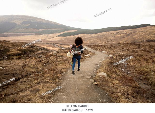 Woman hiking on path, Fairy Pools, Isle of Skye, Hebrides, Scotland