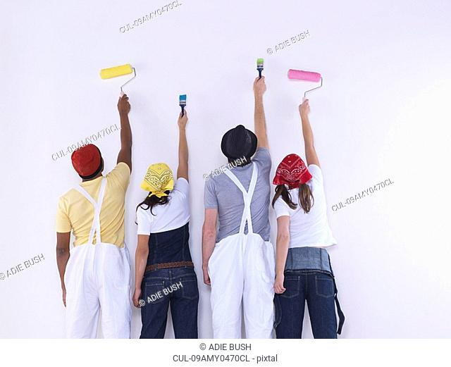 Group of friends about to paint wall