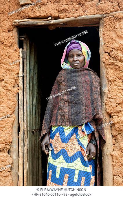 Muslim lady standing at doorway of hut, Rwanda
