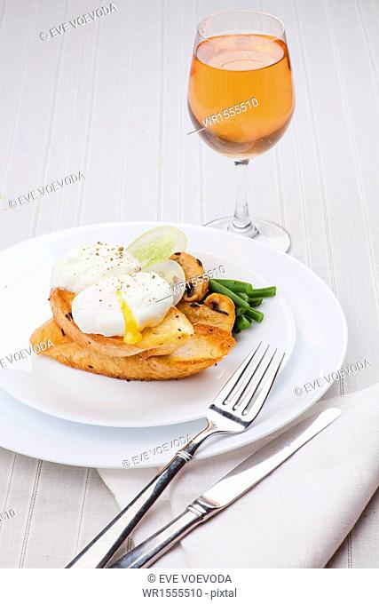 poached egg with salad, mushroom and bread