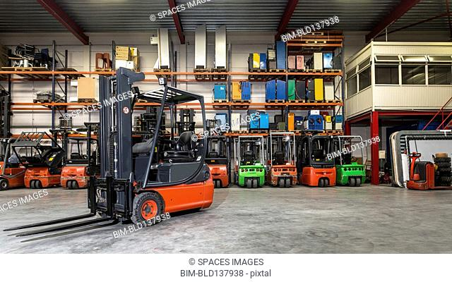 Forklift machinery in warehouse