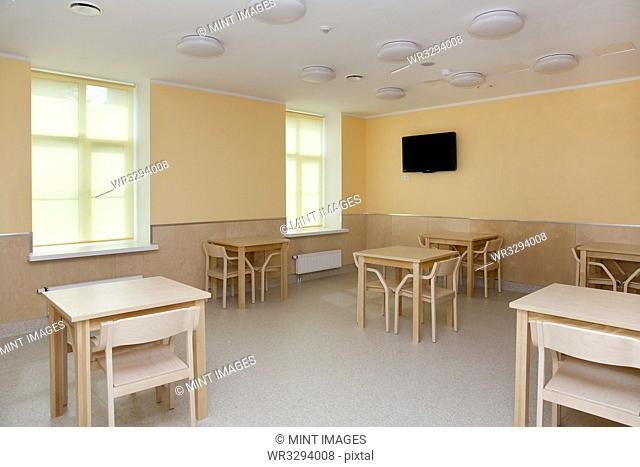 Hospital Room With Tables and Chairs