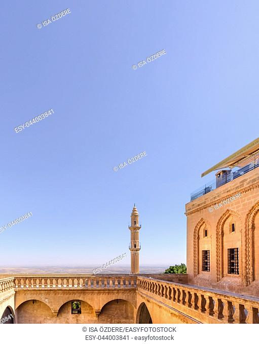 View of Sehidiye Mosque and Madrassa from top of ancient building landmark in Mardin,Turkey. 17 June 2018