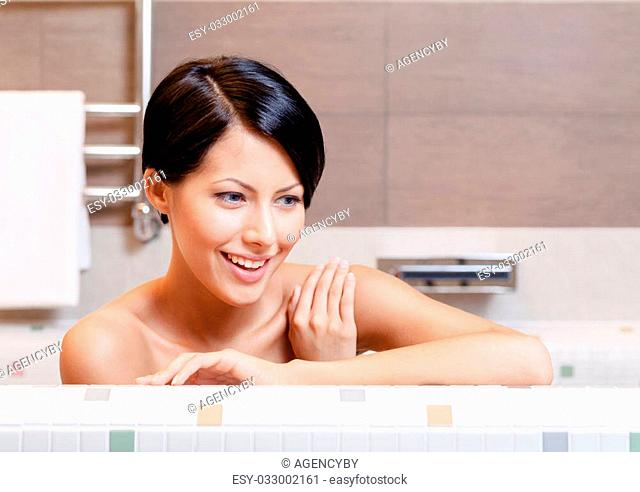 Beautiful pretty woman relaxes in bath, hygiene concept