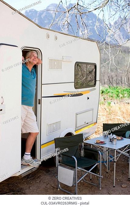 Older man at door of RV
