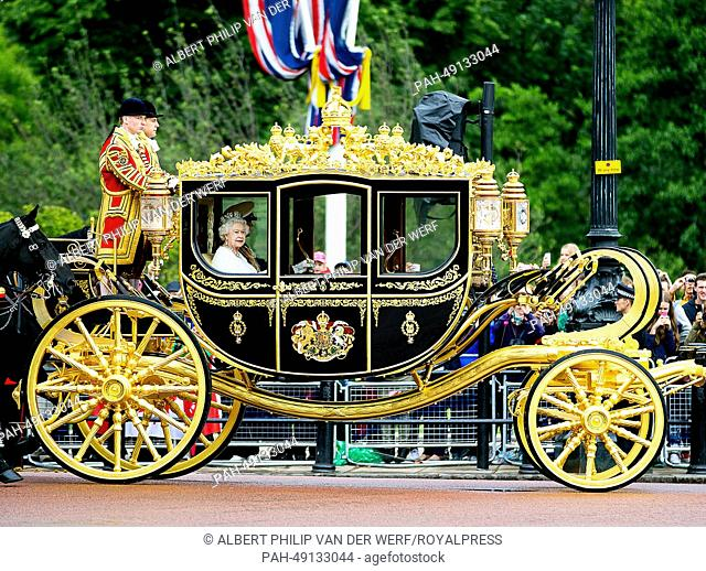 Britain's Queen Elizabeth II makes her way by royal carriage along The Mall for her State Opening of Parliament Speech in London, Britain, 04 June 2014
