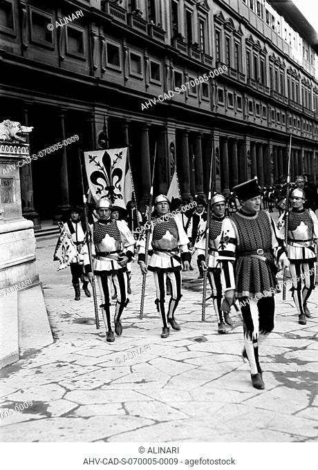 Costume parade during the Calcio Storico Fiorentino in Piazza della Signoria in Florence. In the background the Uffizi Palace (1560 -1580 ca