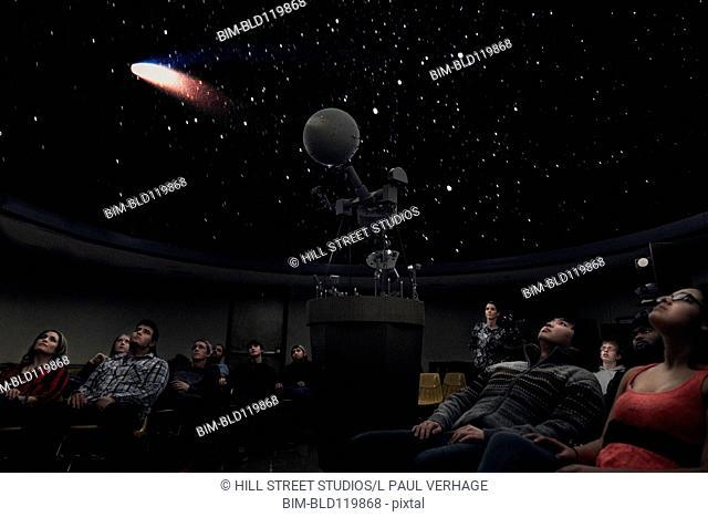 Students watching comet in planetarium