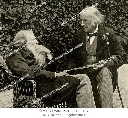 JOHN RUSKIN English art critic and writer in old age, sitting in his garden at Brantwood, Coniston, with Sir Henry Acland