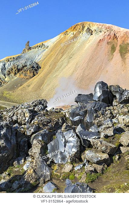 Rocks of the Laugahraun lava field and the Brennisteinsalda mountain on background from the Graenagil footpath in Landmannalaugar (Fjallabak Nature Reserve