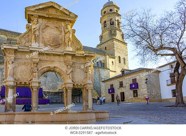 Baeza, Andalusia, Spain, March 2018: View of the Santa Maria fountain and the bell tower of the cathedral