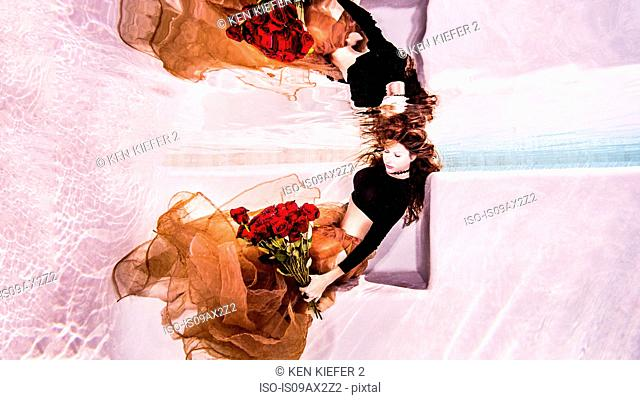 Woman underwater with roses