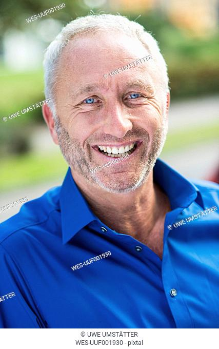 Portrait of smiling businessman outdoors