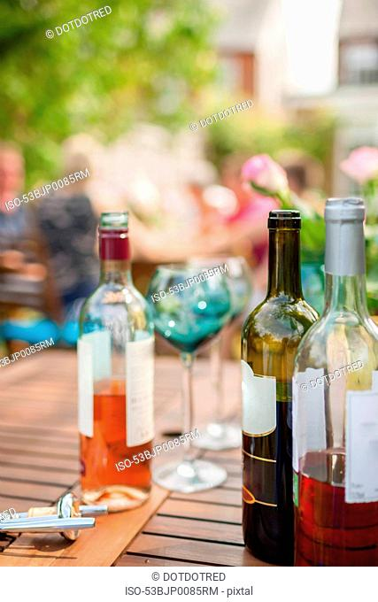 Bottles of wine on table outdoors
