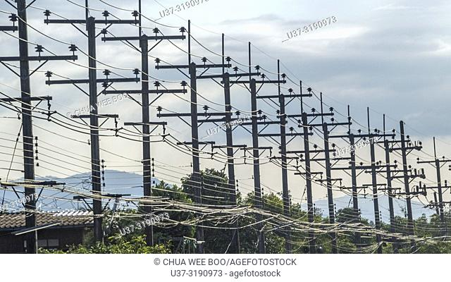 Power lines along the highway of Chiang Mai, Thailand