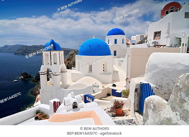 Landscape with greek white church overlooking the sea, Oia Town, Santorini Island, Greece