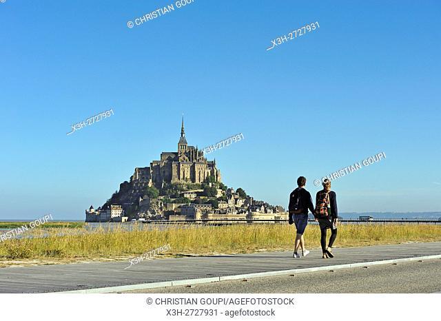 tourists walking on the new footbridge towards the Mont-Saint-Michel, Manche department, Normandy region, France, Europe