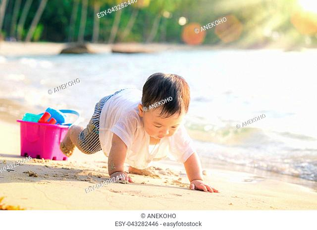 Asan baby play on the beach in Koh Kood, Koh Kood is island in Thailand. This images can use for kid, baby, play, resort, family and travel concept