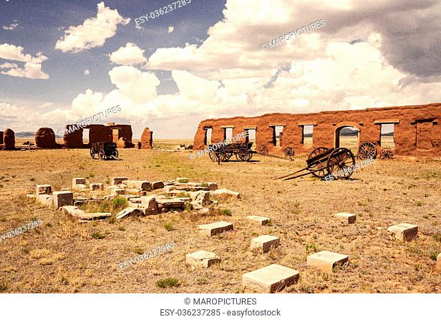 Vintage looking old picture of ruins and wagons at Fort Union