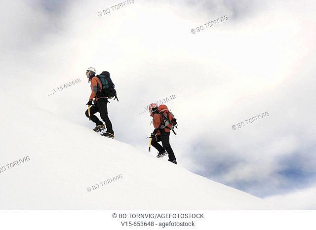 Mountaineer climbing Snowy Mountain