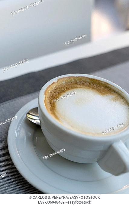 Cup of coffee in an elegant restaurant in the Italian city of Venice