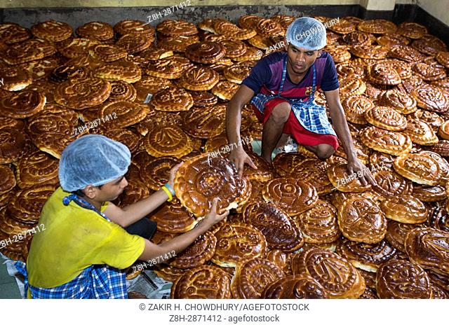 DHAKA, BANGLADESH - MAY 11 : Bangladeshi bakery worker prepare special bread in preparation for the Islamic holy day Shab-e-Barat or the night of vigil in Dhaka
