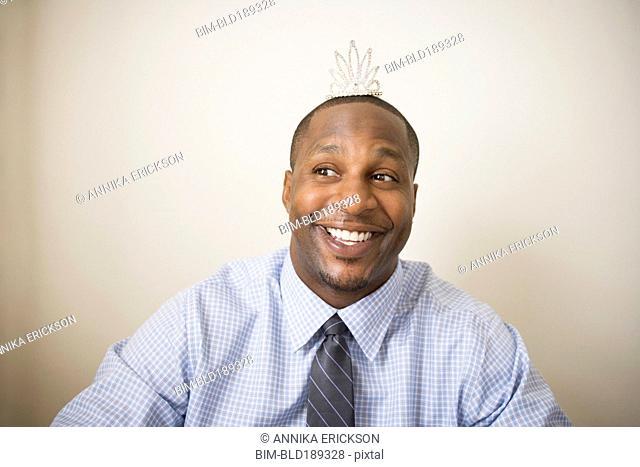 African man wearing tiara