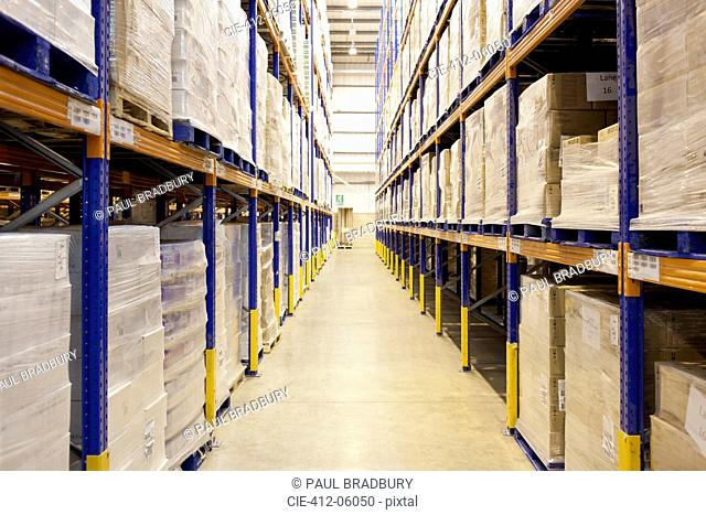 Stacks of boxes in aisle in warehouse