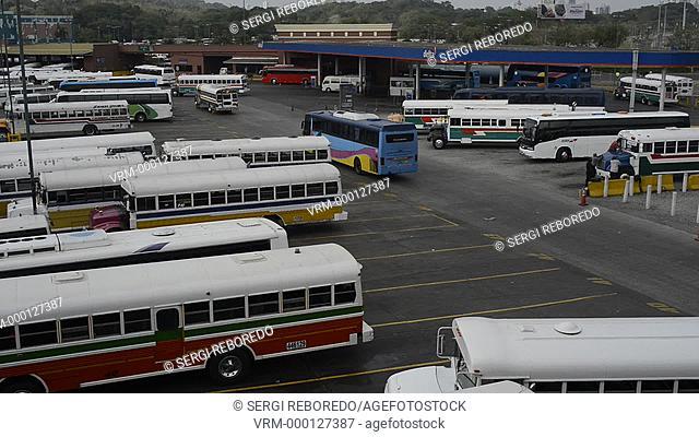 BUS RED DEVIL DIABLO ROJO PAINTED BUS PANAMA CITY REPUBLIC OF PANAMA. Albrok bus station terminal. Panama. Here comes the Diablo Rojo