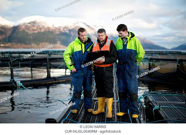 Workers at salmon farm in rural lake
