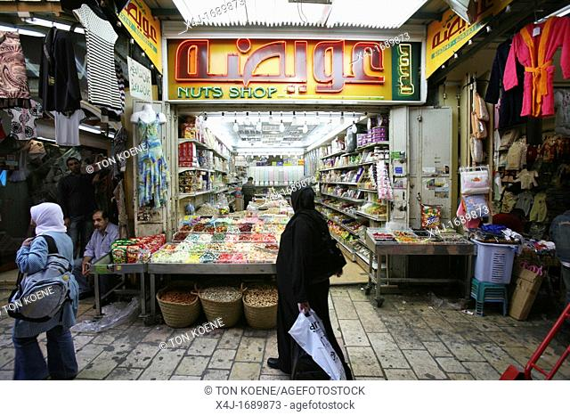 A shop selling nuts in a market in the old city section of Jerusalem
