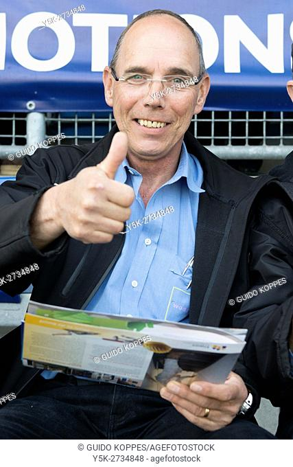 Tilburg, Netherlands. A residential housing companies manager giving a thumbs up during a caretaker's conference