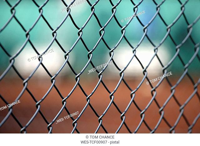 Germany, Bavaria, Tennis court seen through fence, close-up