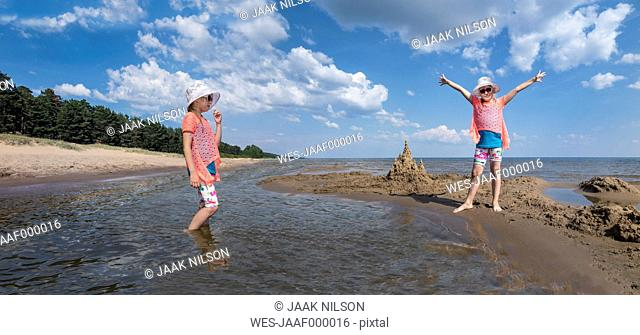 Estonia, Lake Peipus, Kauksi beach, digital composite of girl in shallow water and on beach