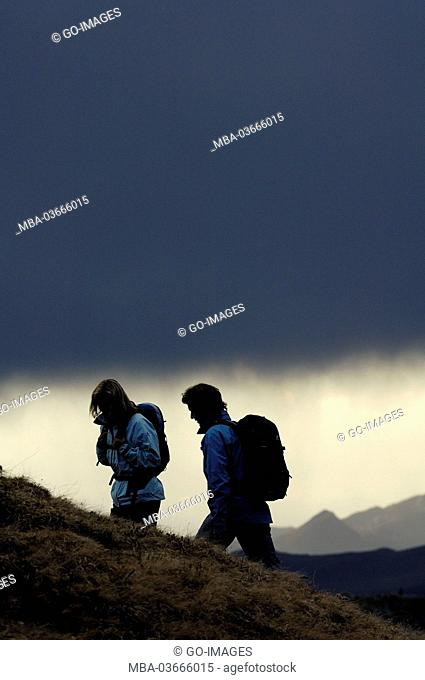 couple, hiking, storm clouds, dolomites