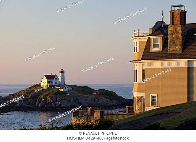 United States, Maine, York, Cape Neddick, Nubble lighthouse and a house in the seaside