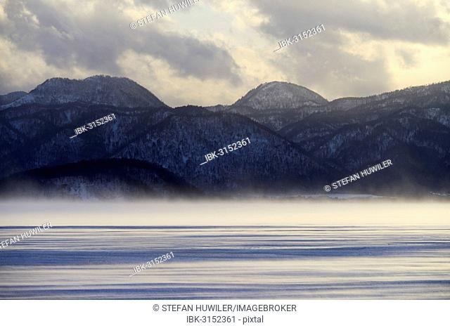 Fog over the frozen Lake Kussharo, Akan-Nationalpark, Kawayu Onsen, Hokkaido, Japan
