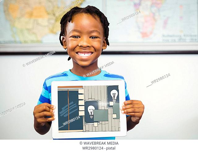 Boy smiling with tablet on his hands, showing the draw of the office on his tablet (color: dark blue