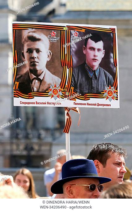 Hundreds gathered in Trafalgar Square and march viaWhitehall,Big Ben, Houses ofParliament and Westminster Abbey in the Immortal Regiment parade