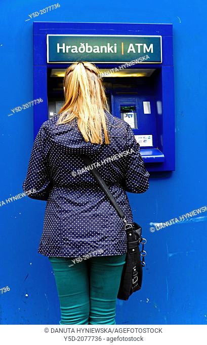 ATM, single young woman, Reykjavik, Iceland