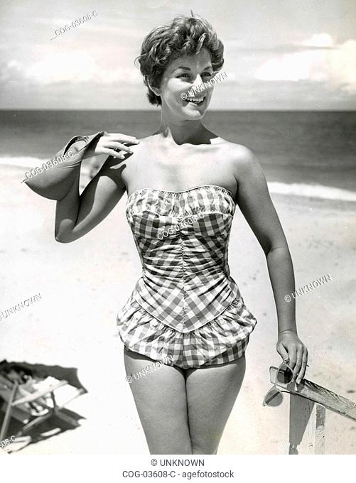 A model presents a swimsuit 50s