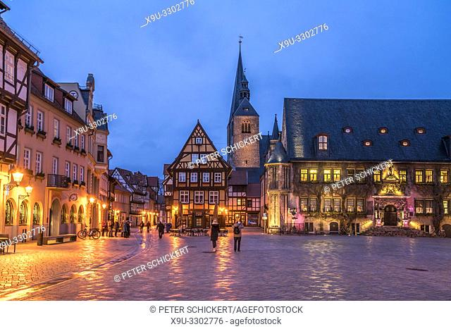 market square with town hall and Market Church St Benedikti at dusk , Quedlinburg, Saxony- Anhalt, Germany