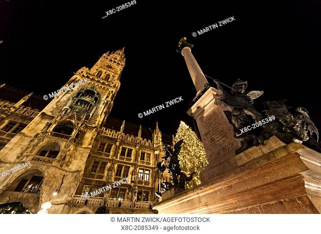 Christmas market in Munich. Marienplatz (Marys Square) and the Neue Rathaus (New City Hall). Europe, Germany, Bavaria, Munich, December 2013