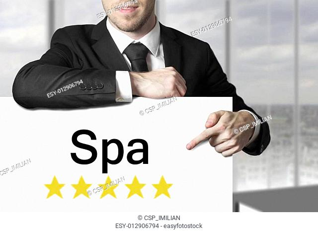 businessman pointing on sign spa golden stars