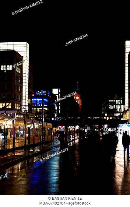 The Berlin Alexanderplatz at night in the rain with the Red Town Hall in the background