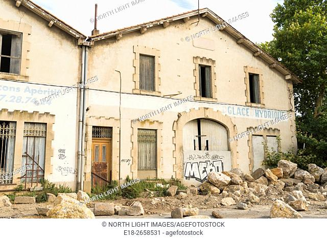 EU, France, Beziers. Derelict old graffiti covered houses near the River Orb