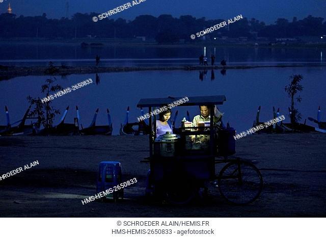 Myanmar, Mandalay, Mandalay Province, next to U Bein Bridge, Lake Thaugthung and a street vendor