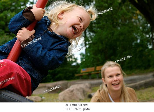 Mother and daughter at a playground Sweden