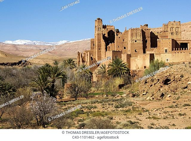 Morocco - The beautiful Tamdaght kasbah = fortress is located just a few km north of the world-famous kasbahs of Aït Benhaddou  In the background the...